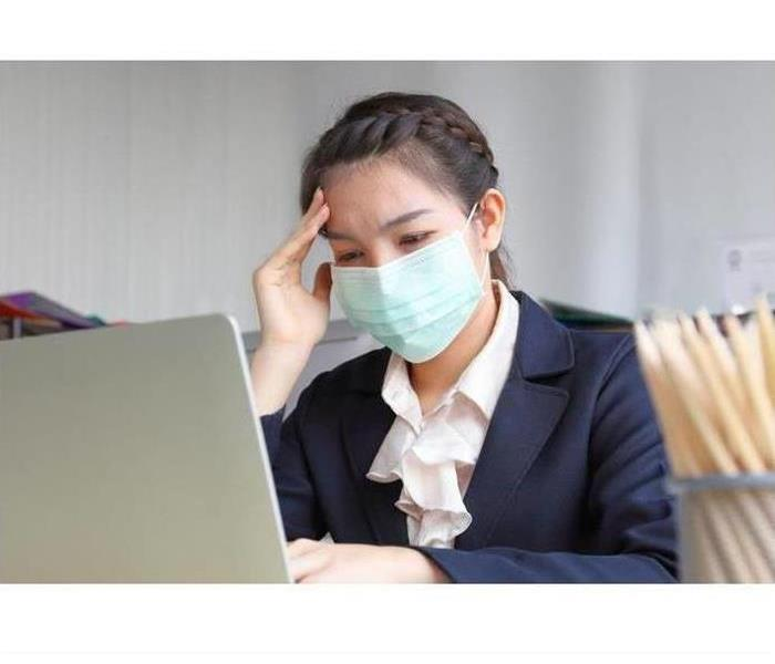 Photo of Female with Mask working on her computer